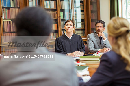 Judge and lawyers talking in chambers Stock Photo - Premium Royalty-Free, Image code: 6113-07762391