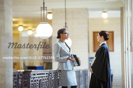 Judge and lawyer talking in courthouse Stock Photo - Premium Royalty-Free, Image code: 6113-07762398