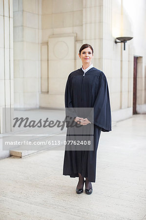 Judge standing in courthouse Stock Photo - Premium Royalty-Free, Image code: 6113-07762408