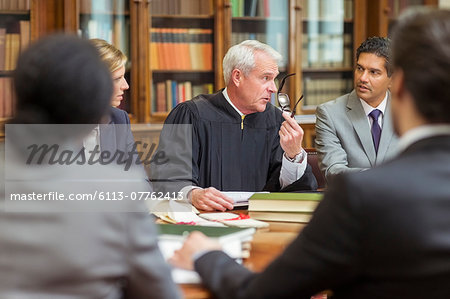Judge and lawyers talking in chambers Stock Photo - Premium Royalty-Free, Image code: 6113-07762413