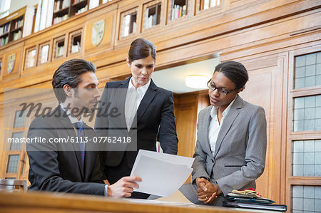 Lawyers examining documents in court Stock Photo - Premium Royalty-Free, Image code: 6113-07762418