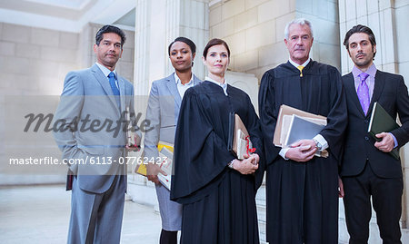 Judges and lawyers standing together in courthouse Stock Photo - Premium Royalty-Free, Image code: 6113-07762423
