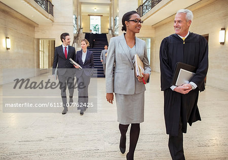 Judges and lawyers walking through courthouse Stock Photo - Premium Royalty-Free, Image code: 6113-07762425
