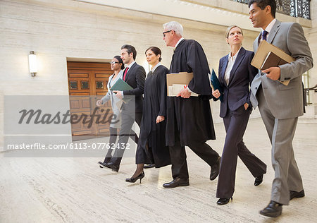 Judges and lawyers walking through courthouse together Stock Photo - Premium Royalty-Free, Image code: 6113-07762432