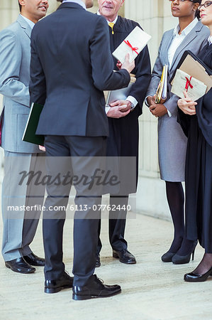 Judges and lawyers talking in courthouse Stock Photo - Premium Royalty-Free, Image code: 6113-07762440
