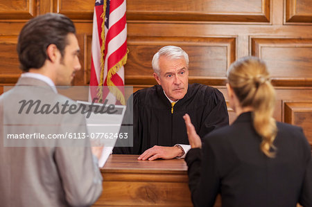 Lawyers pleading case to judge in court Stock Photo - Premium Royalty-Free, Image code: 6113-07762463