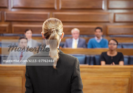 Lawyer pleading case to jury in court Stock Photo - Premium Royalty-Free, Image code: 6113-07762468