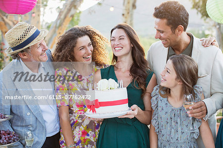 Family celebrating birthday together Stock Photo - Premium Royalty-Free, Image code: 6113-07762472
