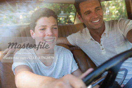 Father teaching son to drive Stock Photo - Premium Royalty-Free, Image code: 6113-07762479