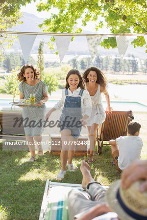 Family running through park together Stock Photo - Premium Royalty-Free, Image code: 6113-07762480