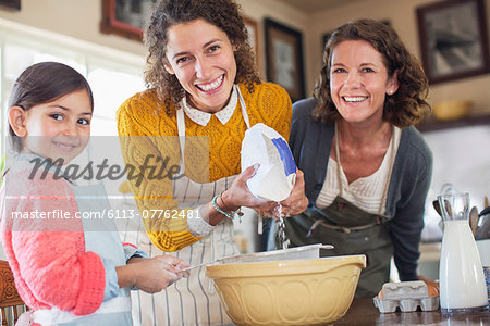 Three generations of women baking together Stock Photo - Premium Royalty-Free, Image code: 6113-07762481