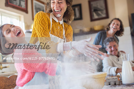 Mother and daughter playing with flour in the kitchen Stock Photo - Premium Royalty-Free, Image code: 6113-07762491