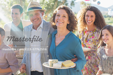 Older couple hugging at family picnic Stock Photo - Premium Royalty-Free, Image code: 6113-07762506