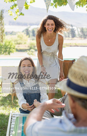 Family playing outdoors Stock Photo - Premium Royalty-Free, Image code: 6113-07762509
