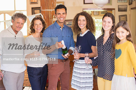 Family celebrating with drinks Stock Photo - Premium Royalty-Free, Image code: 6113-07762513