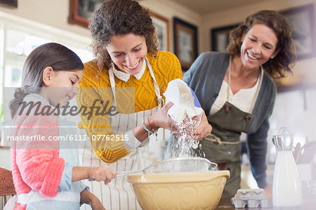 Three generations of woman baking together Stock Photo - Premium Royalty-Free, Image code: 6113-07762515