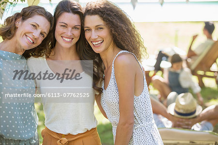 Family hugging at family picnic Stock Photo - Premium Royalty-Free, Image code: 6113-07762525