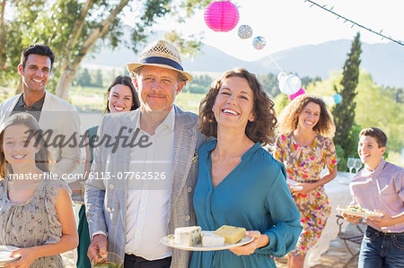 Older couple hugging at family picnic Stock Photo - Premium Royalty-Free, Image code: 6113-07762526