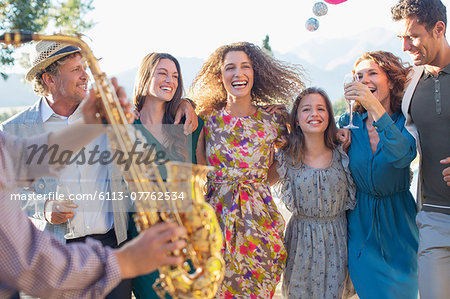 Family dancing together outdoors Stock Photo - Premium Royalty-Free, Image code: 6113-07762534