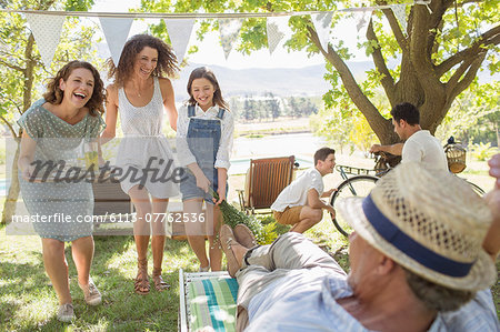 Family enjoying the outdoors together Stock Photo - Premium Royalty-Free, Image code: 6113-07762536