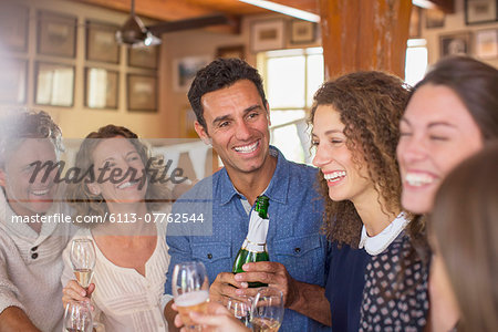 Family celebrating with drinks Stock Photo - Premium Royalty-Free, Image code: 6113-07762544