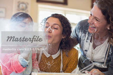 Three generations of women playing with flour Stock Photo - Premium Royalty-Free, Image code: 6113-07762547