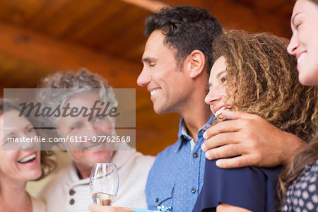 Family laughing together indoors Stock Photo - Premium Royalty-Free, Image code: 6113-07762568