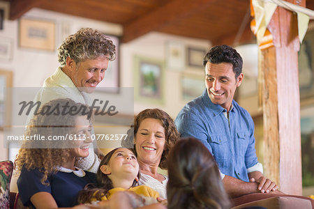 Family gathered on the couch together Stock Photo - Premium Royalty-Free, Image code: 6113-07762577