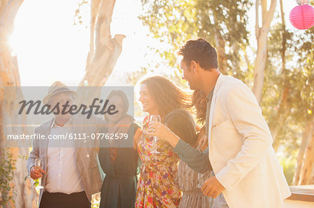 Family celebrating with drinks Stock Photo - Premium Royalty-Free, Image code: 6113-07762579