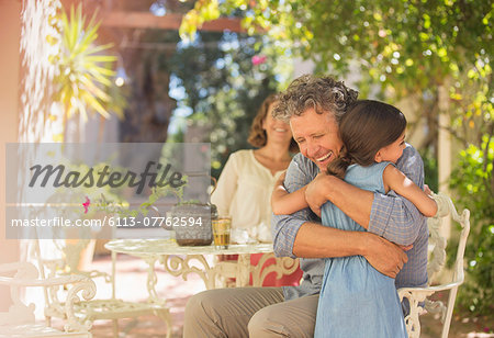 Grandfather and granddaughter hugging outdoors Stock Photo - Premium Royalty-Free, Image code: 6113-07762594