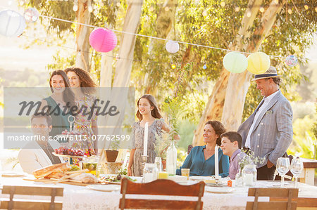 Gathered family looking down the garden Stock Photo - Premium Royalty-Free, Image code: 6113-07762599