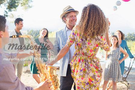 Father and daughter dancing together Stock Photo - Premium Royalty-Free, Image code: 6113-07762610