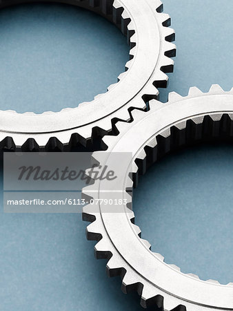 Close up of interlocking metal gears Stock Photo - Premium Royalty-Free, Image code: 6113-07790183