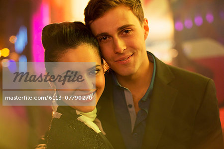 Couple hugging on city street at night Stock Photo - Premium Royalty-Free, Image code: 6113-07790270
