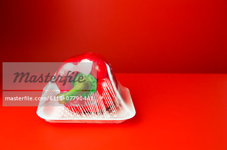 Close up of bell pepper shrink wrapped in plastic Stock Photo - Premium Royalty-Free, Image code: 6113-07790441