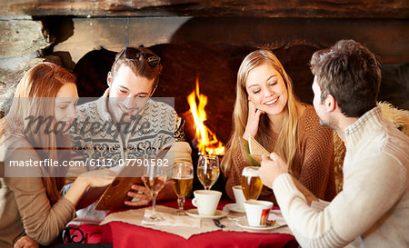 Friends ordering food at restaurant Stock Photo - Premium Royalty-Free, Image code: 6113-07790582