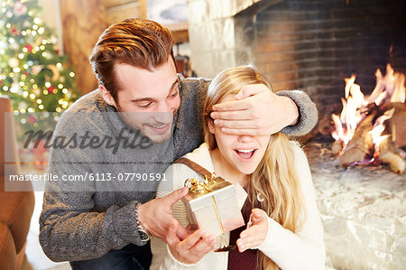 Couple exchanging gifts on Christmas Stock Photo - Premium Royalty-Free, Image code: 6113-07790591