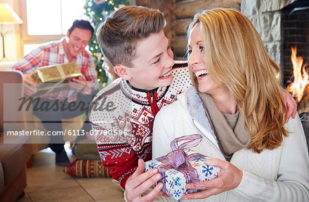 Family exchanging gifts on Christmas Stock Photo - Premium Royalty-Free, Image code: 6113-07790596