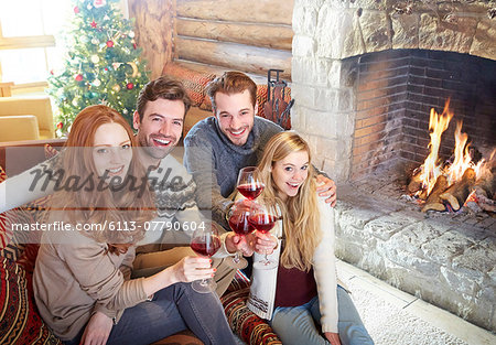 Friends celebrating with drinks in log cabin Stock Photo - Premium Royalty-Free, Image code: 6113-07790604