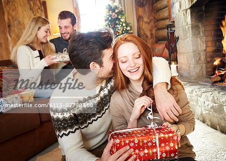 Couple exchanging gifts on Christmas Stock Photo - Premium Royalty-Free, Image code: 6113-07790668