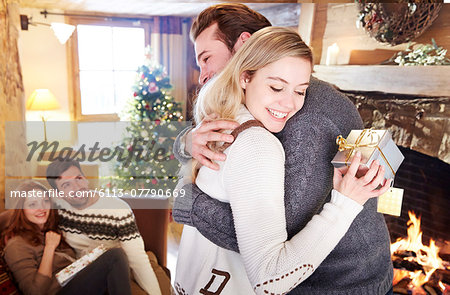 Couple exchanging gifts on Christmas Stock Photo - Premium Royalty-Free, Image code: 6113-07790669