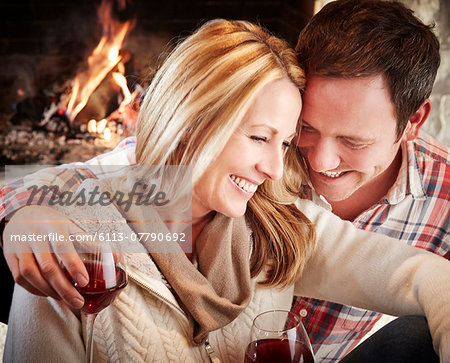 Couple enjoying drinks together Stock Photo - Premium Royalty-Free, Image code: 6113-07790692