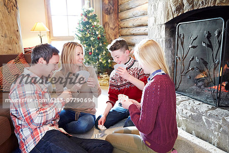 Family playing card game together Stock Photo - Premium Royalty-Free, Image code: 6113-07790694