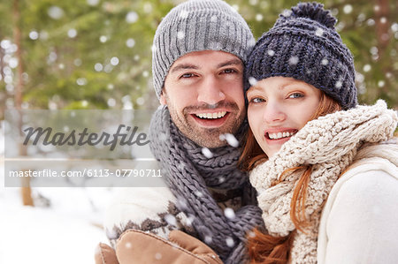 Couple hugging in snow Stock Photo - Premium Royalty-Free, Image code: 6113-07790711