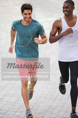 Men running through city streets together Stock Photo - Premium Royalty-Free, Image code: 6113-07790827