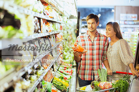 Couple shopping together in grocery store Stock Photo - Premium Royalty-Free, Image code: 6113-07790961