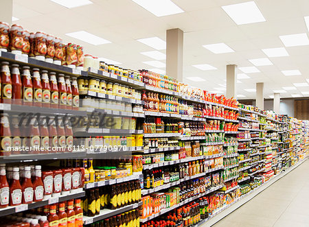 Stocked shelves in grocery store aisle Stock Photo - Premium Royalty-Free, Image code: 6113-07790970