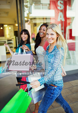 Women carrying shopping bags in shopping mall Stock Photo - Premium Royalty-Free, Image code: 6113-07791081
