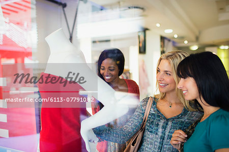 Women shopping together in clothing store Stock Photo - Premium Royalty-Free, Image code: 6113-07791082