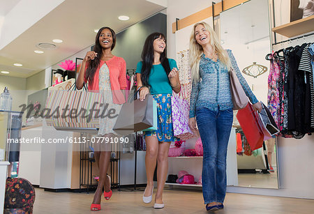 Women shopping together in clothing store Stock Photo - Premium Royalty-Free, Image code: 6113-07791090